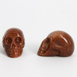 goldstone-(red)-skull-carvings